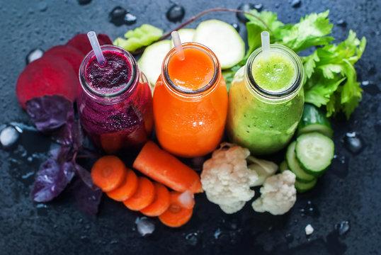Fresh Juice Smoothie Vegetables Orange Green Violet Bottles Color Black Background Selective Focus