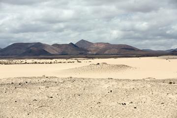 Corralejo sand dunes and extinct volcanoes including montana Roja in the background. Fuerteventura, Canary Islands, Spain