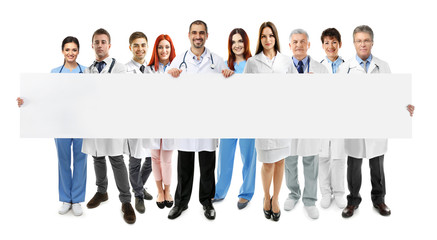 Smiling doctors with white banner, isolated on white