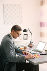 Man working with color samples at office