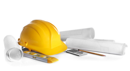 Construction drawings with tools and helmet isolated on white