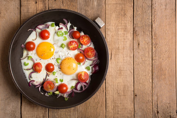 Aluminium Prints Egg Fried eggs with onion and other vegetables