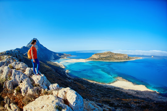 panoramic view on Balos beach, Crete, Greece. Woman, traveller stands on the cliff against sea background