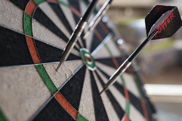 Darts sticking in a dartboard