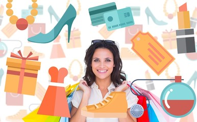 Composite image of pretty brunette with shopping bags