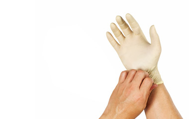 Gesture to wear rubber gloves to protect chemicals.