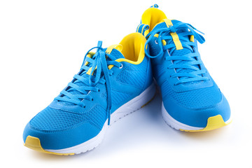 Pair of blue sport shoes on white background