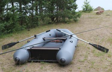 Rubber boat on coast of lake