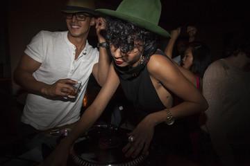 Young woman djing at a club