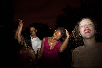 Cheerful friends dancing in the nightclub