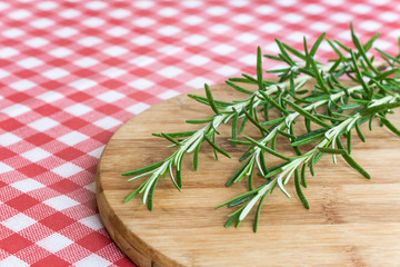 Rosemary branches on the wooden board