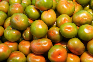 Colorful tomatoes as background. Close up
