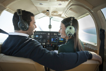 man and woman in private plane