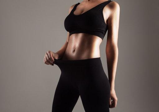 Athlete showing her slim stomach