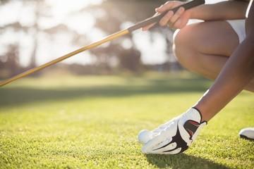 Zelfklevend Fotobehang Golf Cropped golfer man placing golf ball on tee