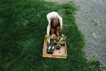 Girl tending homegrown plants