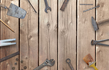Old construction tools with free space for text. Hammer, chisel, brush, paint, wood plane, ruler, shavings, jointer, nail, wrench.