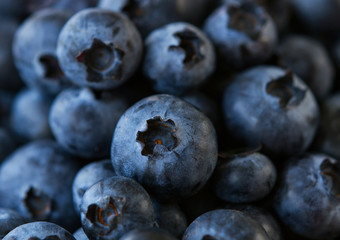 Natural fresh blueberries close up .