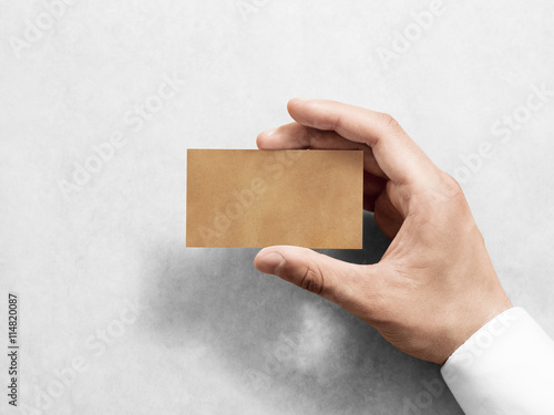 Hand hold blank plain kraft business card design mockup clear hand hold blank plain kraft business card design mockup clear calling card mock up template accmission Images