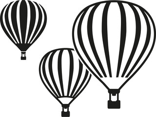 Three flying hot air balloons