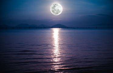 Wall Mural - Romantic scenic with full moon on sea to night. Reflection of moon in water.