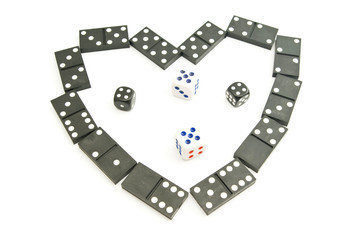 dominoes chips and dices on white