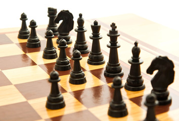 black chess figures on chessboard