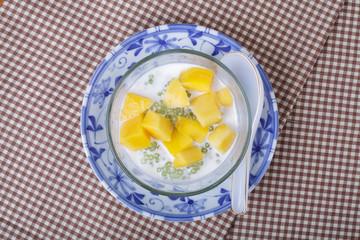 Thai dessert of sago with coconut milk and mango