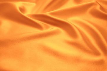 orange satin fabric as background