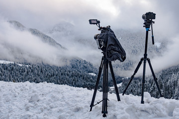 Two Cameras Shooting Timelapses of Mountain Forest Landscape in Nature