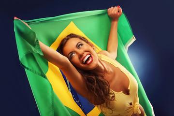 Happy Brazilian fan cheering with flag