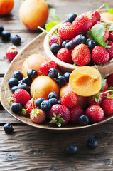 Concept of summer healthy food with strawberry, blueberry and ap
