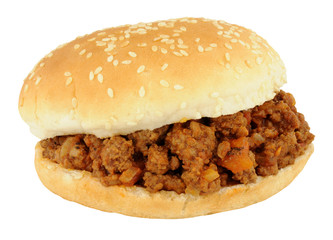 Sloppy joe sandwich in a sesame seed covered bread roll isolated on a white background