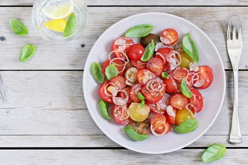 Tomatoes salad with basil and shallot. Concept of healthy eating.Selective focus