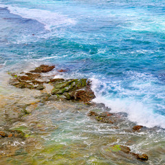 background of ocean waters and coastal stones
