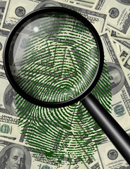Magnify glass and fingerprint on US currency