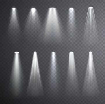 Bright white light beam. Glowing light effects isolated on checkered transparent background. Set of spotlights lighting