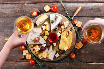 Different kinds of cheese on wooden background