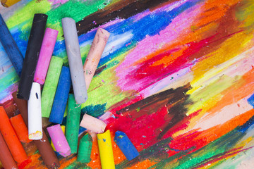oil pastels crayons on colorful background