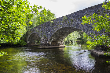 River Balvag with old arched stone bridge