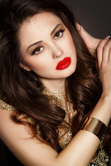 Fahsion brunette woman with bright makeup isolated in studio