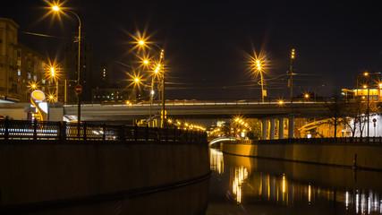 embankment,  reflection in water , motion night scene