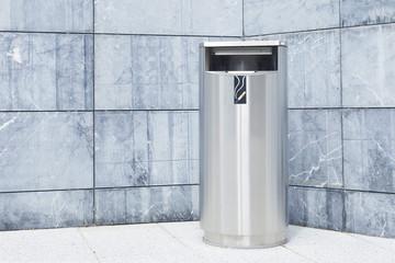 Metallic trash bin on the street, outdoors. Stainless steel litter bin, with a ashtray.