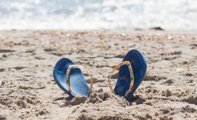 Flip-flops in the sand of Teresitas beach.