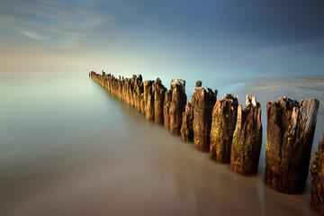 A breakwater on a sandy beach in Debki, Poland, Europe. Baltic sea.