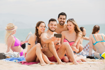 Friends doing selfie picture  at sea shore