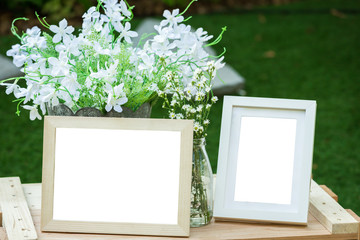 Wooden photo frame and flowers