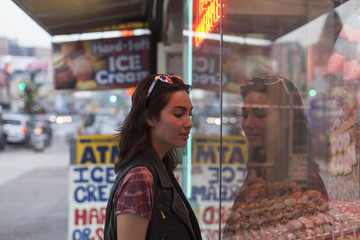 Young woman looking at a store front