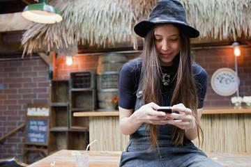 Beautiful young woman using a smart phone