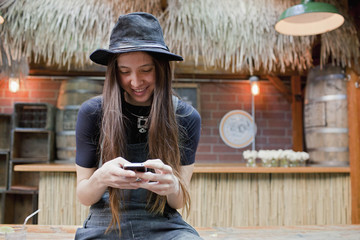 Smiling young woman using a smartphone